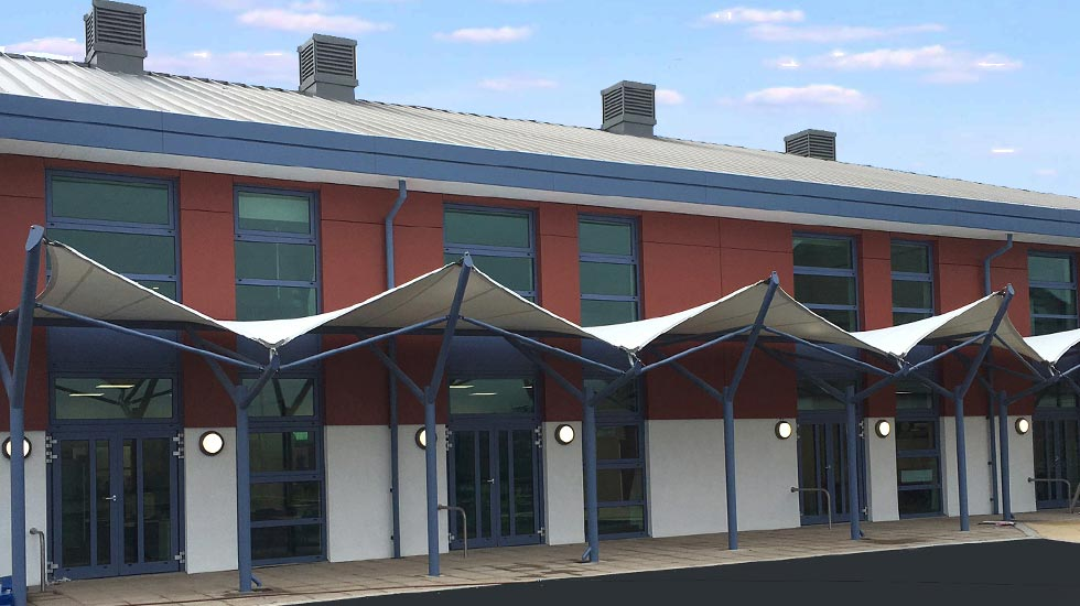 Tensile fabric walkway canopies