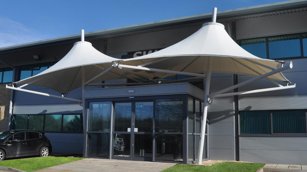 Tensile fabric entrance canopies